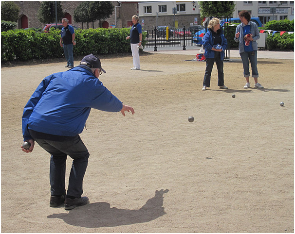 bocce ball being thrown dirt